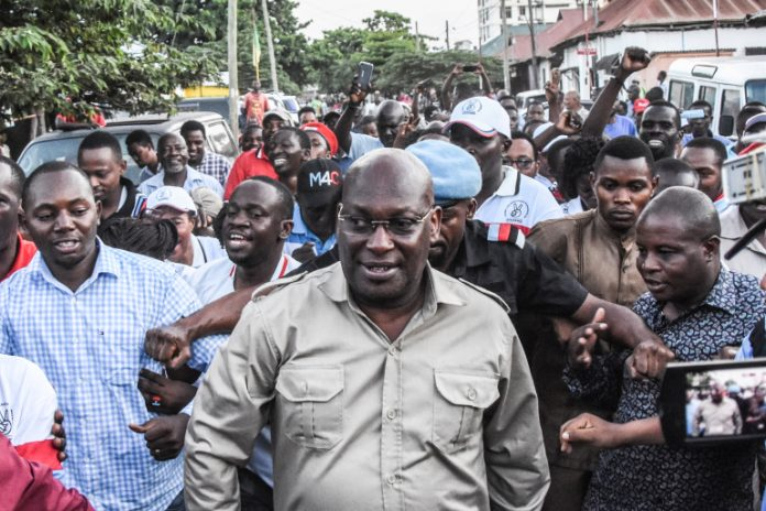 Tanzania Chadema party chairman Freeman Mbowe, centre, was arrested in the Lake Victoria port city of Mwanza [File: Ericky Boniphace/AFP]