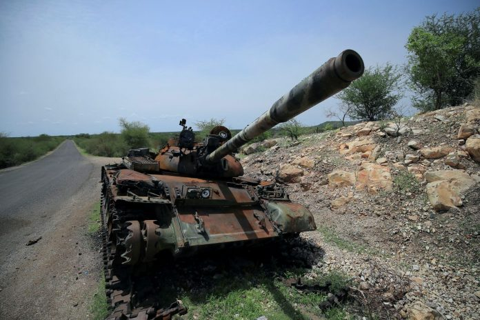 A tank damaged during the fighting between Ethiopia's National Defense Force (ENDF) and Tigray Special Forces stands on the outskirts of Humera town in Ethiopia July 1, 2021. REUTERS/Stringer/File Photo/File Photo