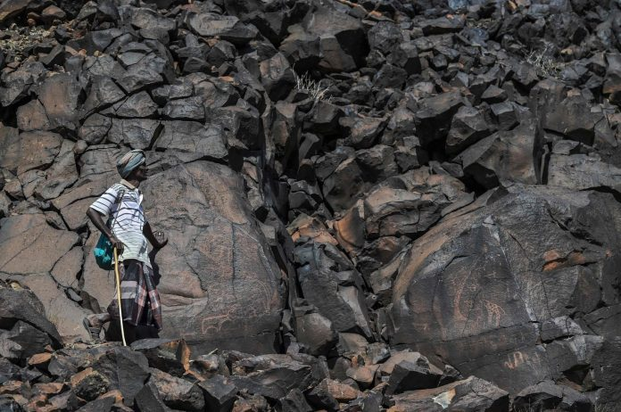 Ibrahim Dabale, 50, an art guardian and native of Djibouti, shows ancient depictions at the remote Abourma Rock Art site in the Makarassou Massif of Tadjoura Region, nothern Djibouti, April 13, 2021. (AFP Photo)