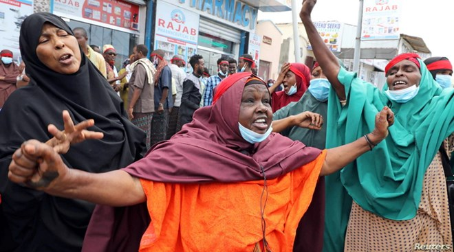 Somali women react at a protest against the African Union Mission in Somalia outside the Erdogan Hospital following the killing of civilians during a gunfight between AMISOM and al-Shabab fighters in the Lower Shabelle region, in Mogadishu, Aug. 12, 2021.