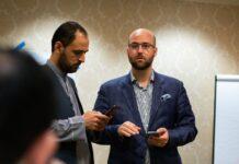 Afghanistan's deputy ambassador to Qatar, Barakat Rahmati, left, and Zach Van Meter at the Willard Hotel in Washington, working on rescue efforts in Afghanistan.