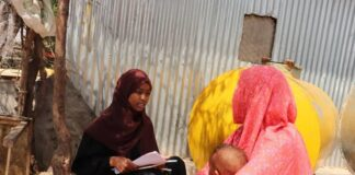 Som-Act researcher conducting a survey at IDP DIgaale camp