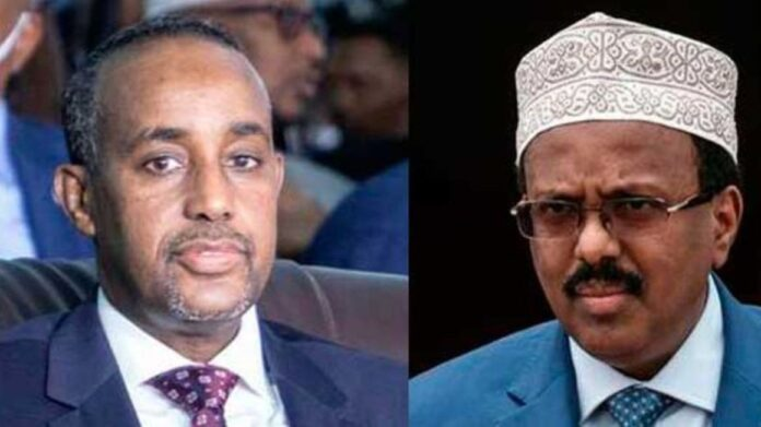 Somalia's Prime Minister Hussein Roble and President Mohamed Farmaajo. PHOTO   AFP